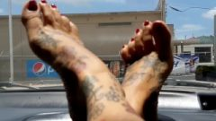 HD SeXy Tattooed Milf Feet Red Toenail Wiggles On Car Dash