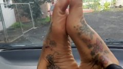 Hot Upclose Inked Feet And Wiggly Toes On Car Dash